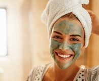 Woman practicing self-care while wearing face mask