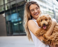 Woman deciding if pet insurance is worth the cost