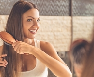 Woman using best stay-at-home haircare products