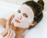Woman wearing best sheet mask