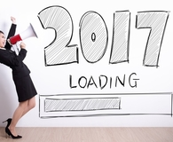 Woman making new year's resolutions for 2017