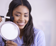 Woman applying great brand name beauty buys under $20