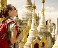 Woman finding ways to travel while paying student loans