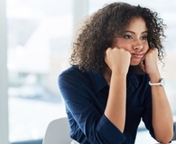 Woman sitting at work bored