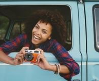 Woman using travel hacks on summer road trip