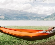 Woman using the best hammock while camping