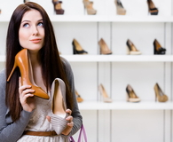 Woman cannot choose stylish pumps