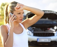 Woman learning common car repair mistakes that can cost her