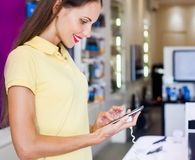 Woman choosing a new mobile phone in a shop