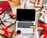 Woman using miles and points for holiday gifts