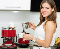 Woman using best descaler on coffee maker