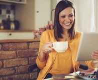 Woman making simple financial upgrades during breakfast