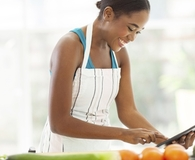 Woman learning which foods to cook by age 30