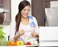 Woman using meal planning sites to save money