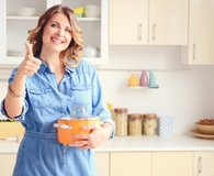 Woman making easy DIY kitchen improvements