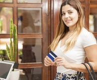 Woman using prepaid cards that are about to get safer