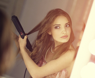 Woman curling her hair with best hair curler