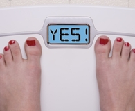Woman using best smart scale to determine weight