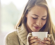 Woman using coffee hacks that improve her morning