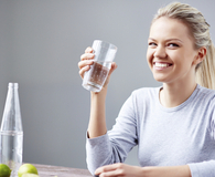 Woman using tricks to drink more water