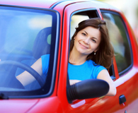 Woman driving car with insurance plan that isn't worth it