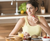 Woman using breakfast hacks to start her day off right