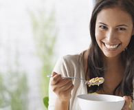 Woman eating easy and delicious bowl of granola