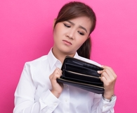 Woman learning mindless ways she's wasting money