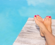 Woman using best foot creams to get pretty feet