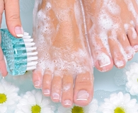 Woman using best foot scrubbers on feet