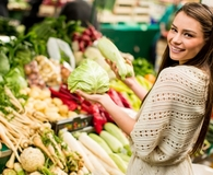 Woman buying groceries that will be cheaper in 2017