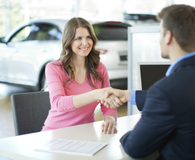 Woman haggling with salesman for new car