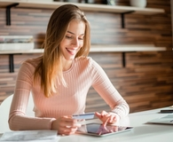 Woman taking steps to get excellent credit