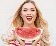 Woman trying amazing food hacks this summer