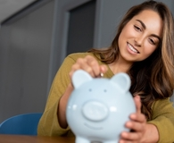 Woman saving money when she can't afford to