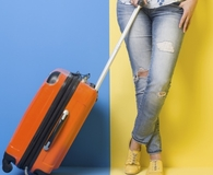 Woman learning how to save on airline baggage fees