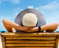 Woman in hat relaxing on beach