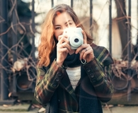 Woman using the best instant cameras