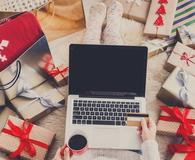 Woman makes Christmas shopping online with laptop