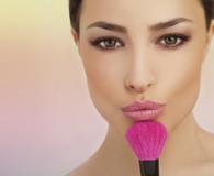 Woman holding best makeup brush sets
