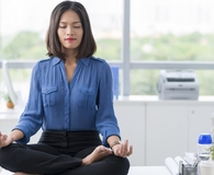 Woman becoming money master through meditation
