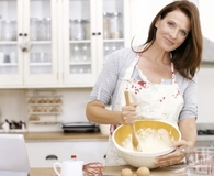 Woman using best kitchen mixing spoons