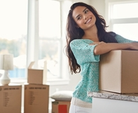 Woman deciding what to keep when downsizing
