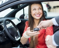 Woman making money mistakes everyone makes with their first car