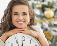 Woman making budget New Year's resolutions now