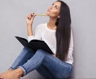 Woman creating reverse bucket list for money management
