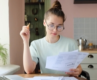 Woman paying off four types of debt