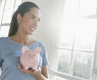 Woman learning why her personal savings rate matters
