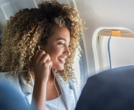 Woman making most of her airline miles