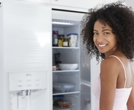 Woman learning if green appliances actually save her money